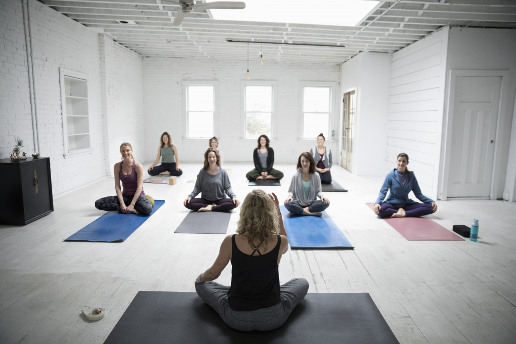 Offering a free yoga class is a great client appreciation event idea.